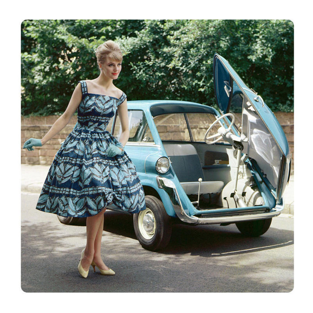 Girl in blue car, picture on the wall made of plexiglass 29 x 29 cm